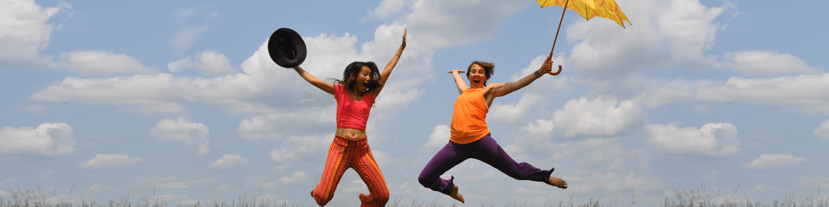 Two girls jumping in celebration